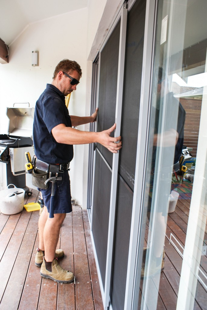A final round of checks are made to approve the door and installation are exact.